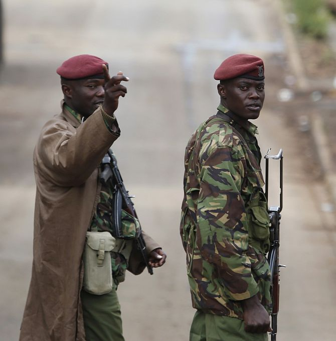 A Kenyan soldier gestures near Westgate shopping centre in Nairobi