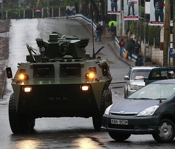 A Kenya Defence Forces (KDF) armoured military vehicle drives to the Westgate shopping centre