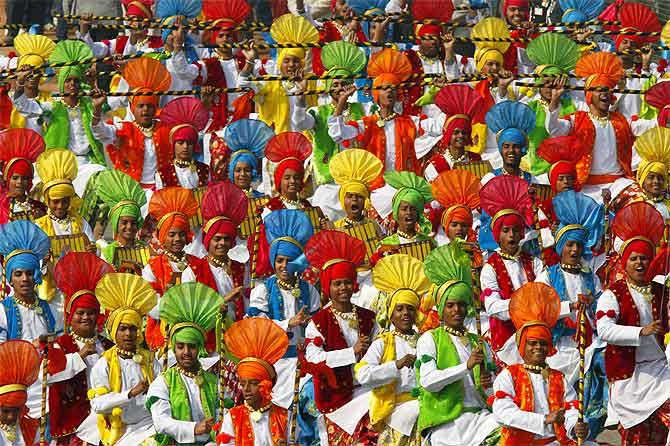 Schoolchildren perform during the Republic Day parade in New Delhi.