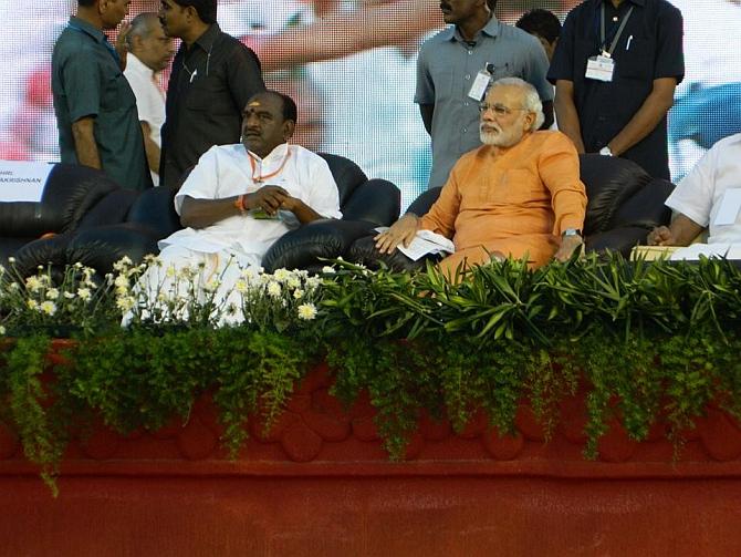 Gujarat Chief Minister Narendra Modi with Tamil Nadu BJP president Pon Radhakrishnan in Trichy