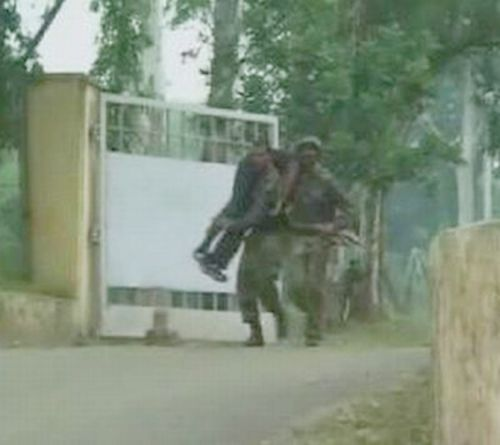 A video grab shows army personnel carrying their colleague on shoulders who was injured in a terror attack on Samba cantonment on Thursday