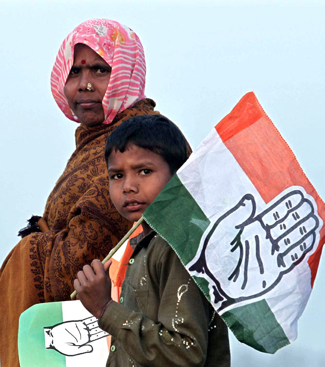 Supporters holding flags of the Congress at Hardoi district in Uttar Pradesh