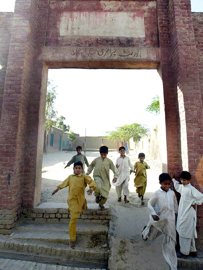 Children leave a primary school in attended by Dr Singh