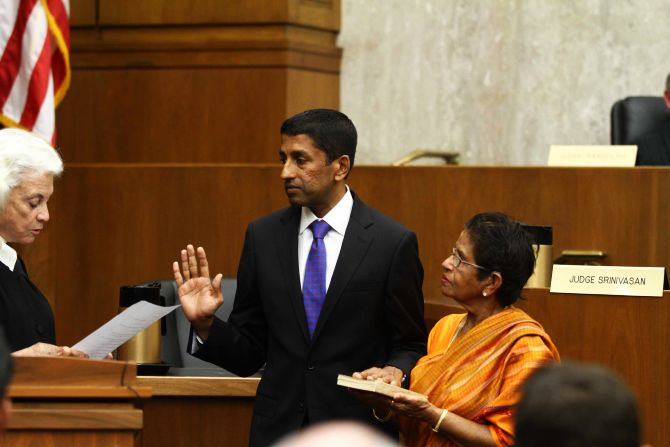 Sri Srinivasan takes oath with his hand placed on Bhagwad Gita beside his mother Saroja Srinivasan