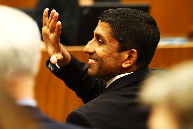 Sri Srinivasan waves to a guest during his swearing-in ceremony