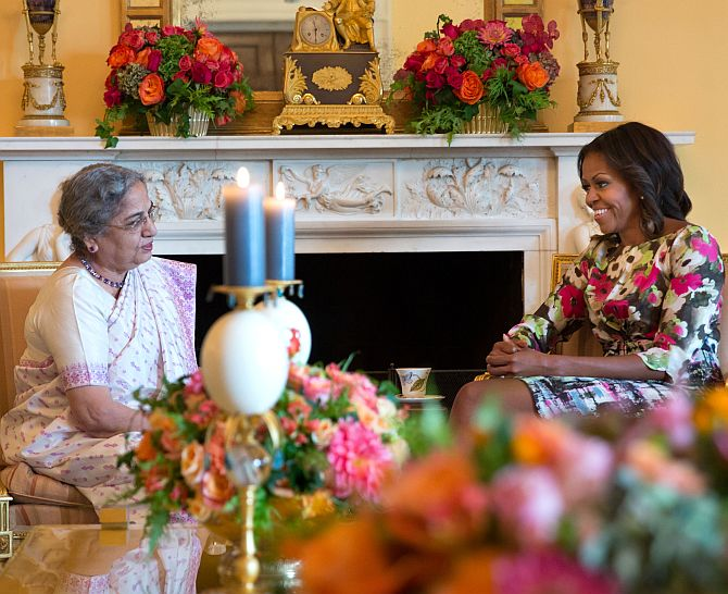 First Lady Michelle Obama hosts a tea for Gursharan Kaur in the Yellow Oval Room of the White House