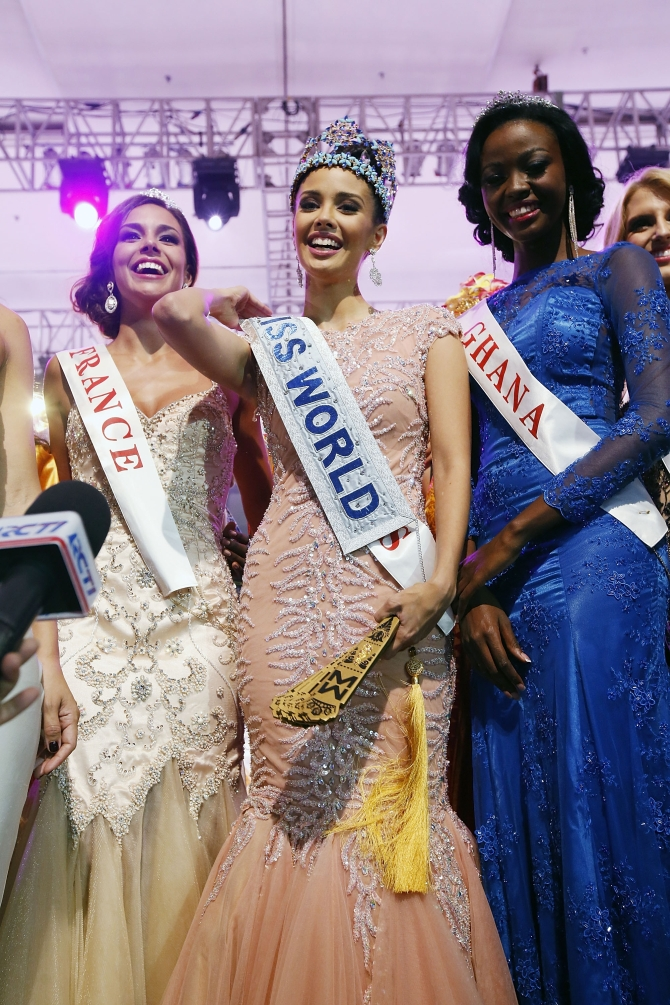 Miss Philippines, Megan Young poses with runner-up Miss France, Marine Lorphelin (L) and second runner-up Miss Ghana, Carranzar Naa Okailey Shooter (R) after she was crowned Miss World 2013