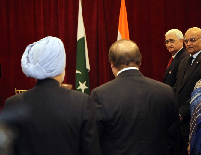 External Affairs Minister Salman Khurshid and National Security Advisor Shivshnakar Menon at the meeting between Dr Singh and Sharif