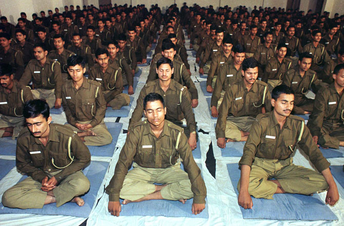 Policemen participate in a Vipassana meditation programme in Delhi