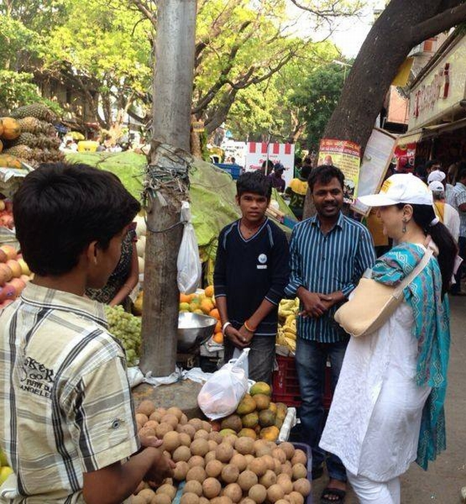Nandan Nilekani's wife Rohini interacts with vegetable vendors in South Bangalore.