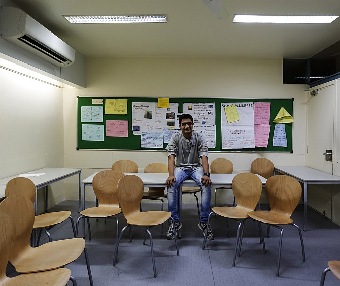 Anuj Trivedi, a 19-year-old student, poses inside his classroom at an institute in Mumbai