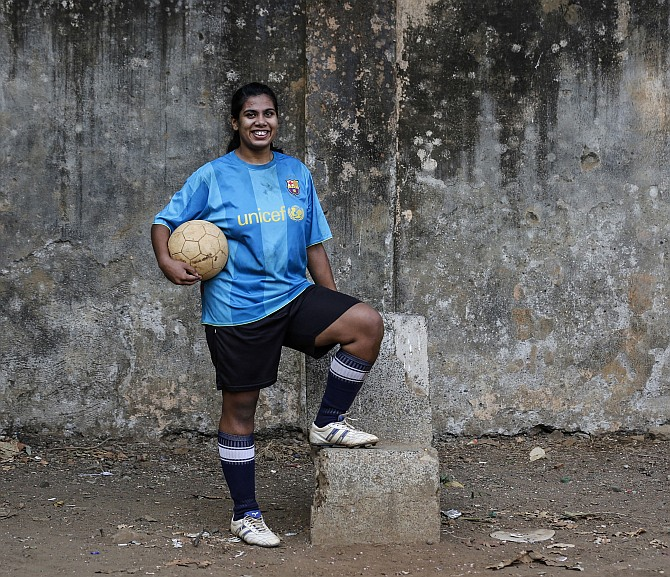 Rachel Blaekly, an 18-year-old student, poses during a football practice session at a playground in Mumbai.