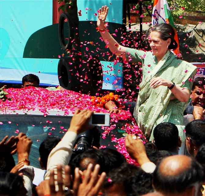 Sonia Gandhi waves to supporters before filing her nominations at Rae Bareli on Wednesday