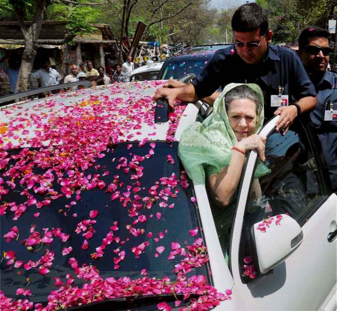 Sonia Ganhdi heads to the collectorate's office in Rae Bareli to file her nomination
