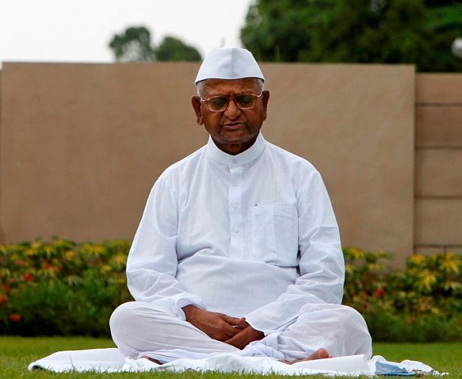 Activist Kisan Baburao 'Anna' Hazare meditates at Rajghat.