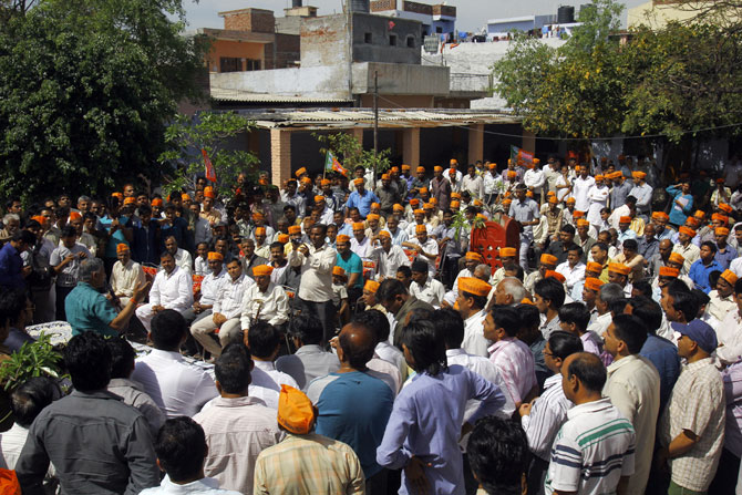 Crowds gather to hear General V K Singh in Ghaziabad's Arthala village.