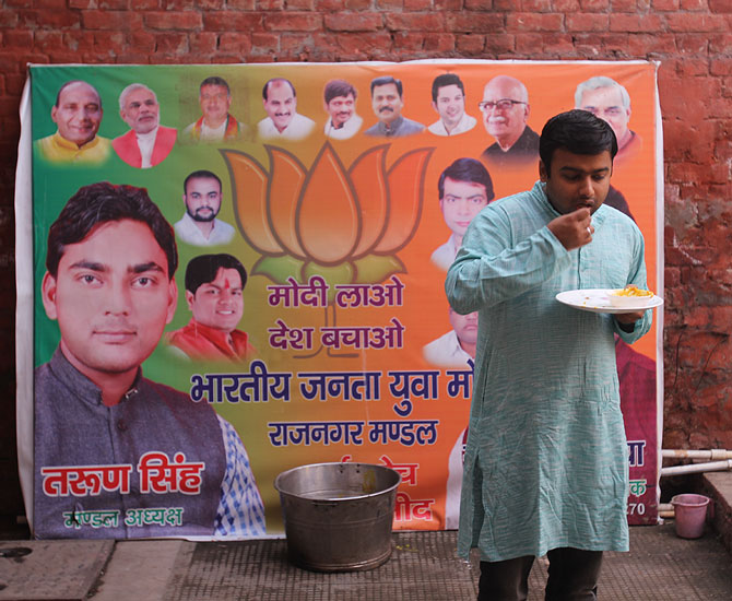 A BJP supporter eats breakfast at General V K Singh's temporary home in Ghaziabad.