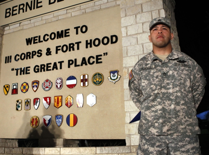 Sgt First Class Erick Rodriguez stands guard before a news conference by Lt Gen Mark Milley at the entrance to Fort Hood Army Post in Texas