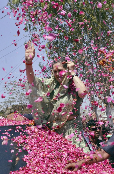 Sonia Gandhi is showered with rose petals after filing her nomination in Rae Bareli.