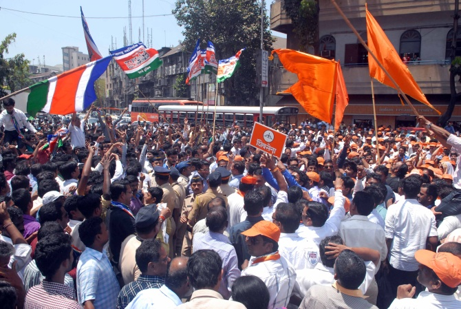 Shiv Sena supporters raise slogans outside the Old Custom House in Mumbai