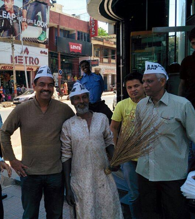 AAP's V Balakrishnan poses for shutterbugs in the middle of a hectic election campaign.