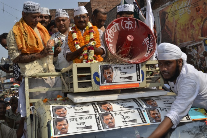 Arvind Kejriwal stands atop a jeep during a public rally in Varanasi.