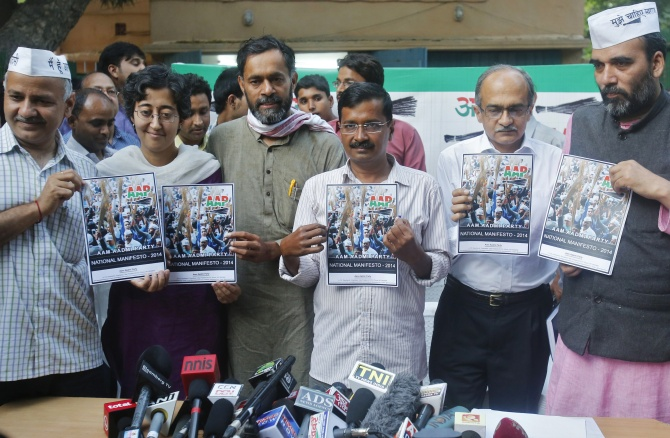 Arvind Kejriwal accompanied by his other party members, hold their party's manifesto ahead of the general election.