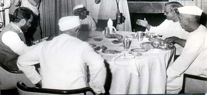 Prime Minister Morarji Desai, back to the camera, with Janata Party leaders.