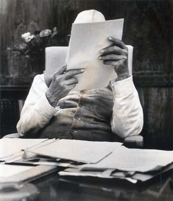 Prime Minister Morarji Desai reads a brief.