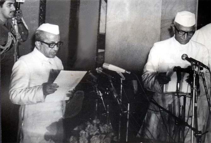 Acting President B D Jatti swears in Morarji Desai as India's first non-Congress Prime Minister.