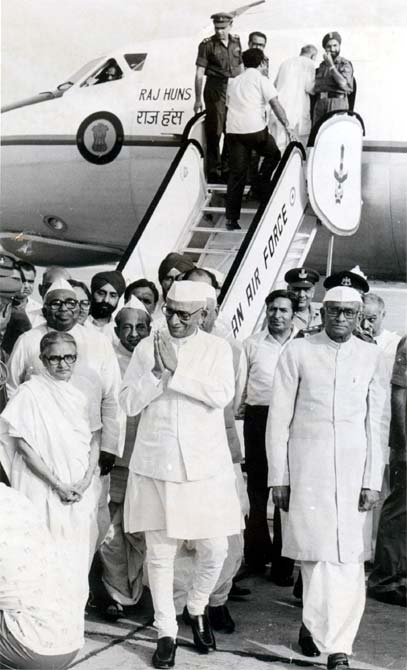 President Neelam Sanjeeva Reddy, right, and Vice-President B D Jatti, behind the prime minister, greet Morarji Desai after his escape in an air crash.