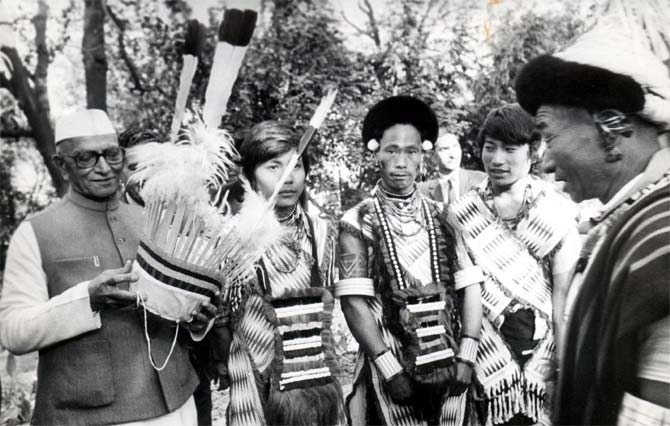 Folk dancers from Nagaland present their head gear to Prime Minister Morarji Desai the day after Republic Day 1978.