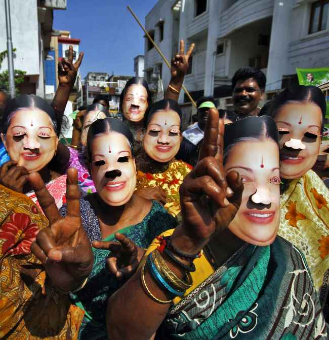 Supporters of AIADMK chief Jayalalithaa campaign in Chennai