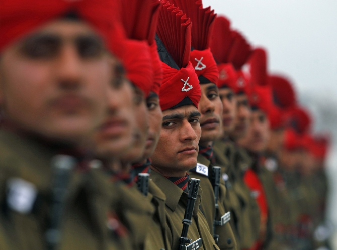 Indian Army recruits take part in their passing out parade at a garrison in Rangreth on the outskirts of Srinagar.