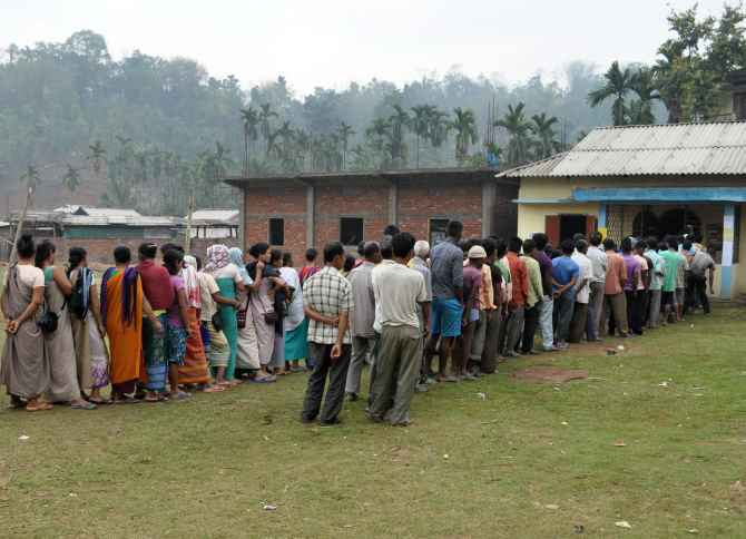 Voters wait in queues to cat their ballots at a polling booth in Harlibagan village, Meghalaya, on Wednesday