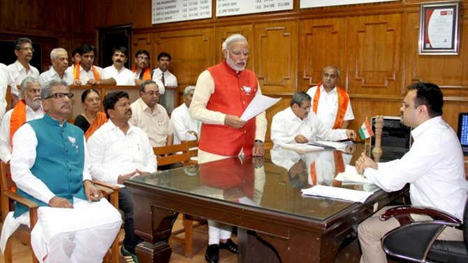 Bharatiya Janata Party's prime ministerial candidate Narendra Modi signing his nomination papers in Vadodara.