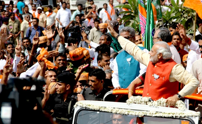 Modi at the road show that was attended by thousands of BJP workers and supporters in Vadodara.