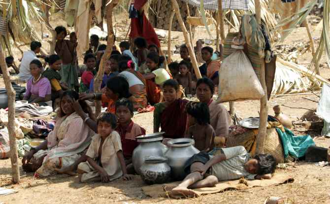 Villagers sit in a refugee camp meant for victims of Maoist violence, in Chhatttisgarh