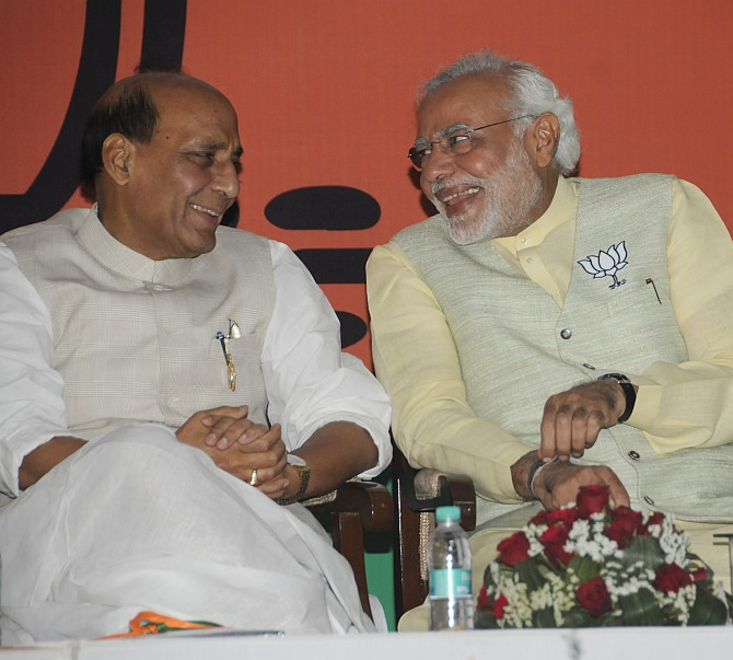 BJP chief Rajnath Singh with party's PM candidate Narendra Modi