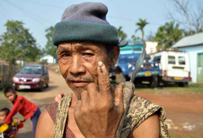 A tribal man shows the indelible mark on his finger after casting his ballot at Harlibagan, 70 kms from Shillong, in Meghalaya on Wednesday