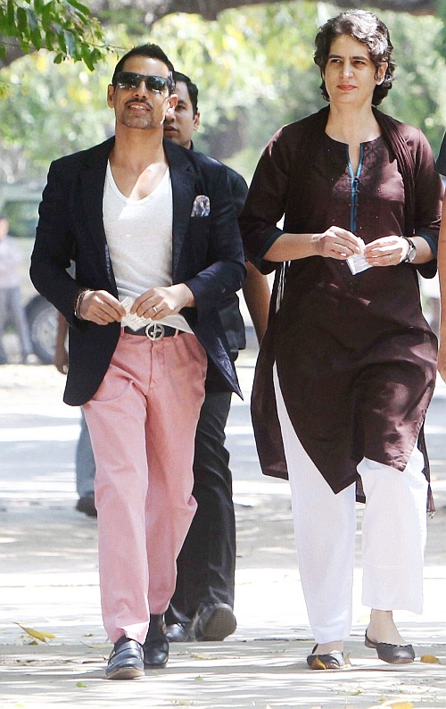 Robert Vadra and his wife, Priyanka Gandhi, step out to vote in New Delhi.