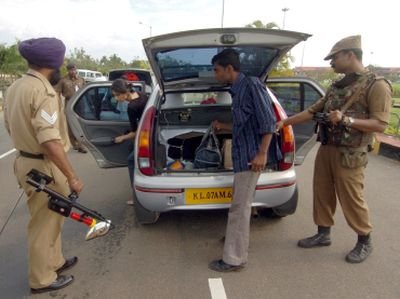Policemen search a car at a checkpoint outside an airport in Kerala. Photograph: Dipak/Reuters. Photograph published for representational purposes only.