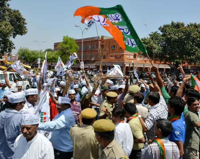 AAP and BJP workers nearly came to blows as their rallies crossed paths in Jaipur on Friday