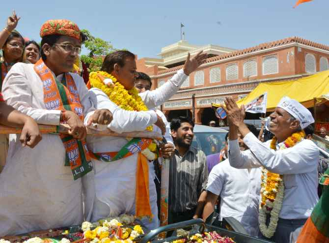 Dr Virendra Singh greets BJP candidate Ramcharan Bohra in Jaipur on Friday