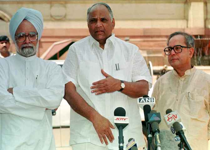 Manmohan Singh, Sharad Pawar and Pranab Mukherjee in this April 1999 archival photograph