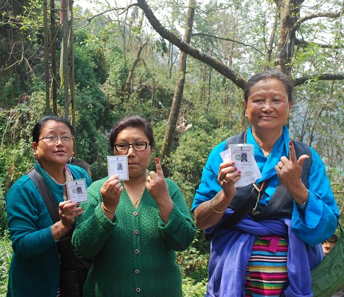 women voters showing the mark of indelible ink after casting their vote at a polling booth in Sikkim