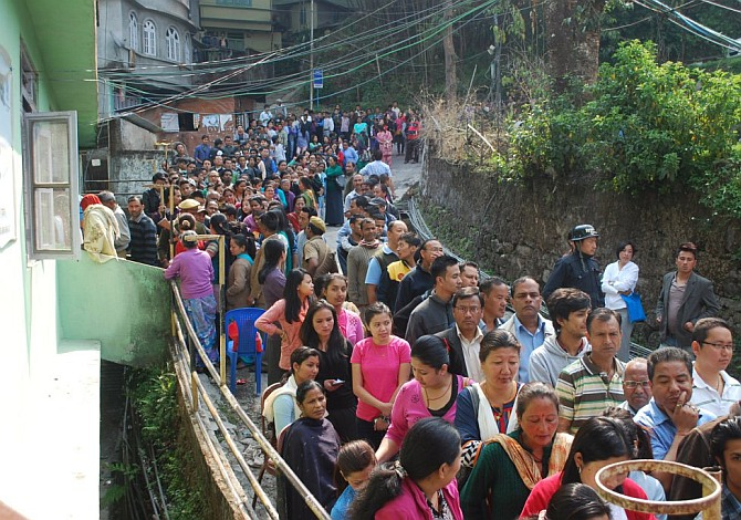 Voters seen in queue waiting for their turn to cast vote at a polling booth in Sikkim