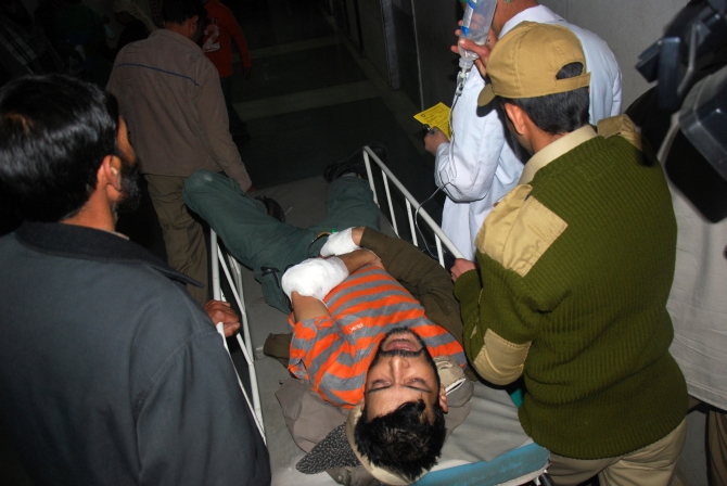 An injured policeman being rushed to the hospital