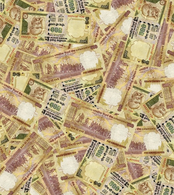 Despite the Election Commission capping the election spending limit for politicians, money is still reaching voters.