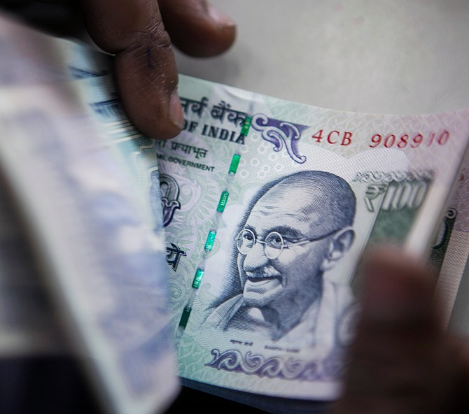 A bank official counts currency notes. Photograph used for representational purposes only.